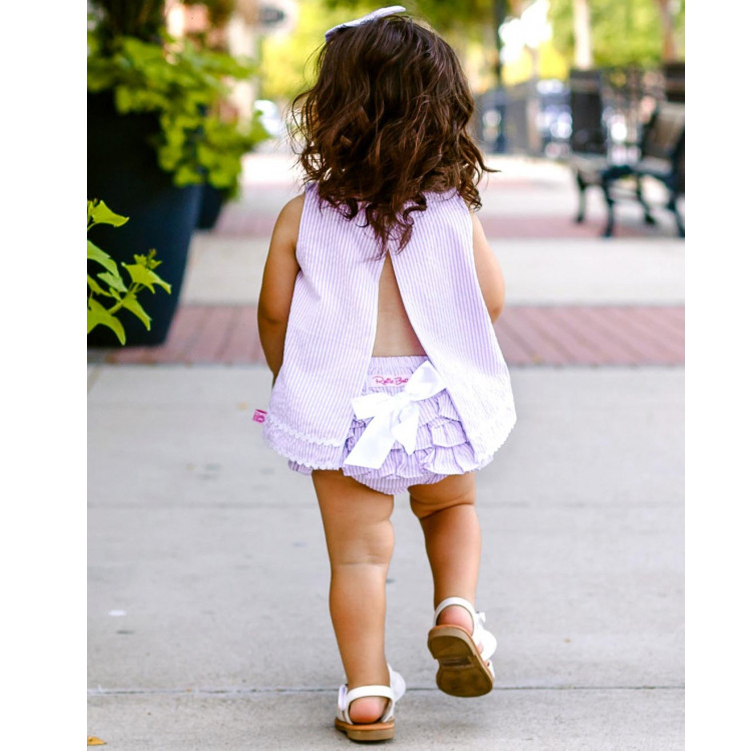 Girls pink ruffle cardigan with button front