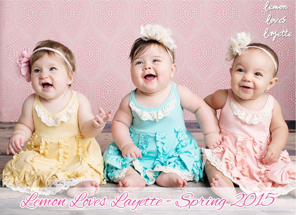 """Dancing Bows"" baby dress, available in double cream, blue, or pink."